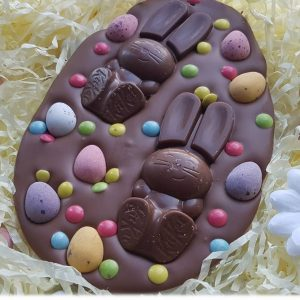 chocolate easte regg shaped slab with chocolate bunnies and chocolate eggs