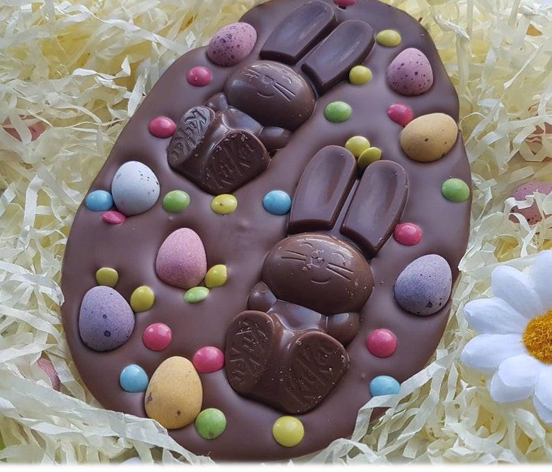 chocolate easte regg shaped slab with chocolate bunnies and chocolate eggs