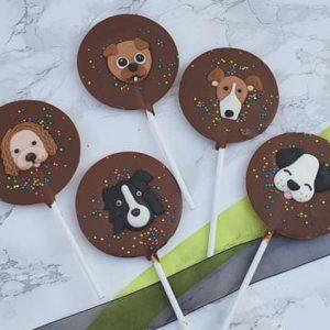 chocolate lollipop with a sugar dog face